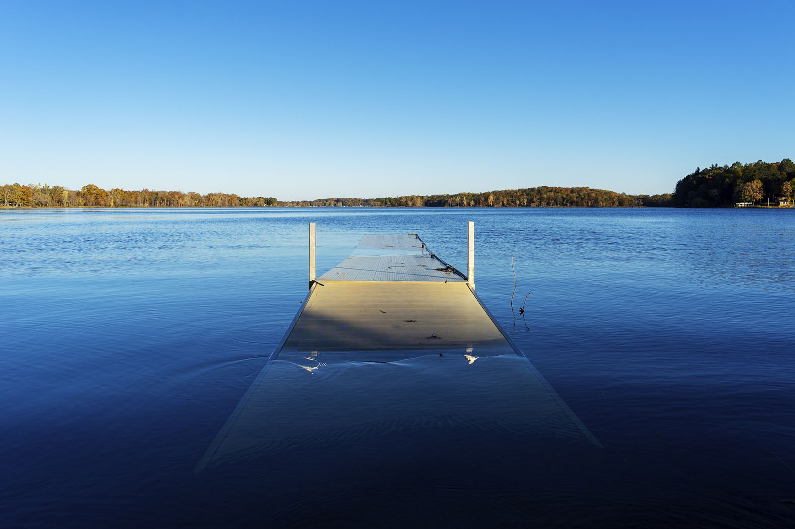 Partially submerged dock on inland lake